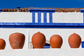 Clay pots stand on white pottery wall in Portugal - PhotoDune Item for Sale
