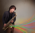 Attractive musician playing on saxophone while colorful abstract - PhotoDune Item for Sale