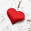 single red heart on white wood background - PhotoDune Item for Sale