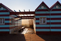 Ocean beach huts at evening sunlight - PhotoDune Item for Sale
