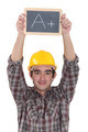 A construction worker holding a slate. - PhotoDune Item for Sale