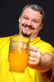 dark smiling man holding a glass of beer - PhotoDune Item for Sale