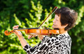 Senior woman performing music outdoors - PhotoDune Item for Sale