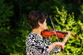 Senior woman playing music outdoors - PhotoDune Item for Sale
