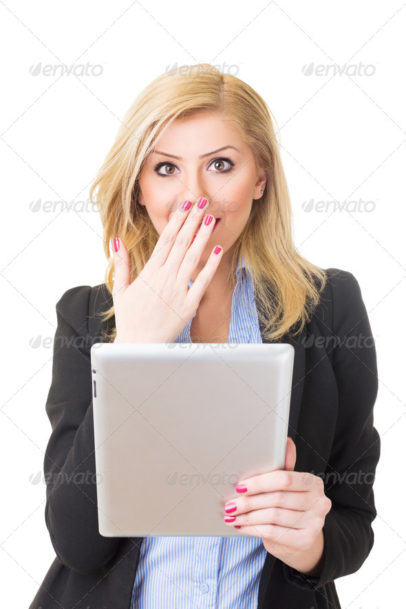 Surprised blonde businesswoman with tablet computer - Stock Photo - Images