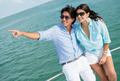 Couple pointing away in a yacht - PhotoDune Item for Sale