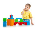 little boy is playing with colorful building blocks isolated on - PhotoDune Item for Sale