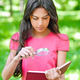 Woman with magnifier holds book - PhotoDune Item for Sale