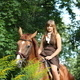 Girl in dress and brown horse portrait in forest - PhotoDune Item for Sale