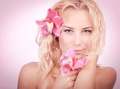 Blond woman with pink orchid - PhotoDune Item for Sale