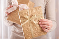 Christmas present in golden wrap - PhotoDune Item for Sale