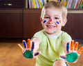 Smiling little boy showing his hands in paints - PhotoDune Item for Sale