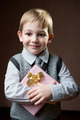 Cute little boy holding dotted present boy - PhotoDune Item for Sale
