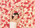young woman with background full of roses - PhotoDune Item for Sale