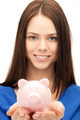 lovely woman with small piggy bank - PhotoDune Item for Sale