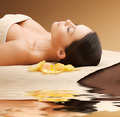 woman in spa salon lying on the massage desk - PhotoDune Item for Sale
