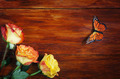 Corner Made of Roses and Butterfly on a Wooden Surface - PhotoDune Item for Sale