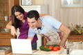Couple following a recipe on a laptop - PhotoDune Item for Sale