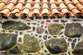 Tiled roof and wall decorated with stones. - PhotoDune Item for Sale