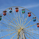 Atraktsion colorful ferris wheel against the blue sky - PhotoDune Item for Sale
