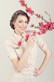 Gorgeous retro styled young woman with pink flowers - PhotoDune Item for Sale
