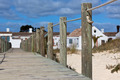 Wooden footpath through dunes at the ocean beach in Portugal - PhotoDune Item for Sale