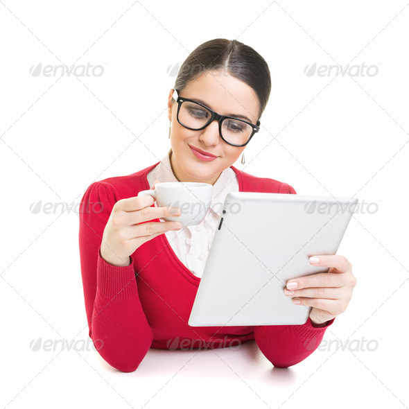 Businesswoman having a coffee break at work - Stock Photo - Images