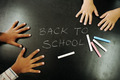 Multiraces children hands on blackboard with chalks: back to school! - PhotoDune Item for Sale