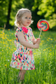Portrait of a little girl with a lollipop - PhotoDune Item for Sale