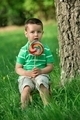 Little boy licking a lollipop - PhotoDune Item for Sale