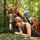 Beautiful girl and brown horse portrait in mysterious forest - PhotoDune Item for Sale
