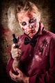 Evil demented zombie holding hand gun. Robbery - PhotoDune Item for Sale