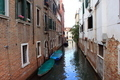 Exposed brickwork buildings along a canal in Venice - Italy - PhotoDune Item for Sale