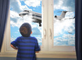 Boy Looking at Flying Airplane in Room - PhotoDune Item for Sale