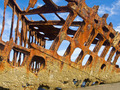 Rusty Wreckage of a Ship on a Beach on the Oregon Coast USA - PhotoDune Item for Sale