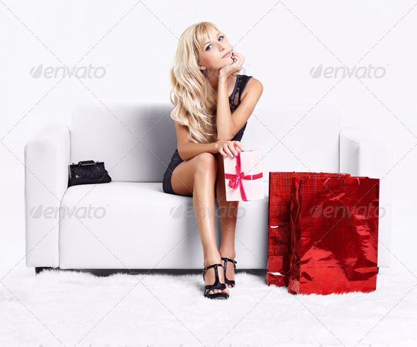 blond girl on sofa - Stock Photo - Images