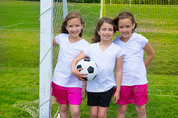 Soccer football kid girls team at sports fileld - Stock Photo - Images
