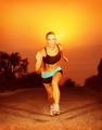 Sporty woman running on sunset - PhotoDune Item for Sale