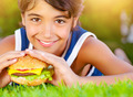Pretty boy eat burger outdoors - PhotoDune Item for Sale