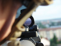Man with military helmet looking through gun scope - PhotoDune Item for Sale