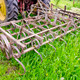tractor on farm field gras with metal harrow - PhotoDune Item for Sale