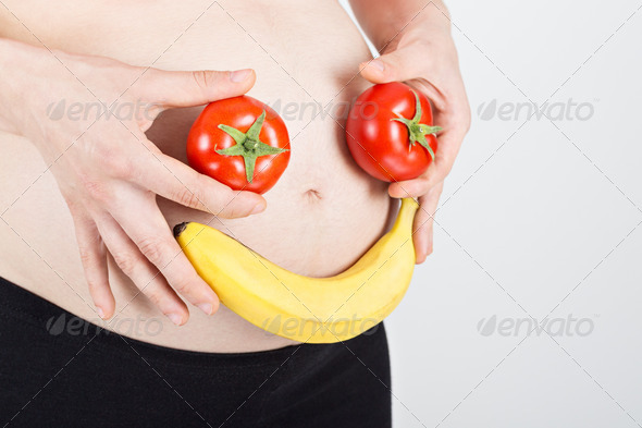 Healthy smile face on pregnancy belly - Stock Photo - Images