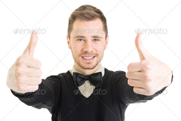 Happy young businessman in black showing thumbs up - Stock Photo - Images