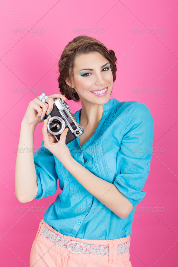 Cute retro young woman with analogue camera - Stock Photo - Images
