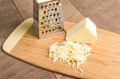 Parmesan cheese grated on a cutting board - PhotoDune Item for Sale