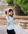 Asian woman at Wat Maheyong Temple. Ayutthaya province - Thailan - PhotoDune Item for Sale