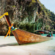 Traditional longtail boats in the famous Maya bay of Phi-phi Leh - PhotoDune Item for Sale