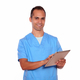 Young male in nurse uniform using tablet pc - PhotoDune Item for Sale