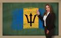Teacher showing flag ofbarbados on blackboard for presentation m - PhotoDune Item for Sale