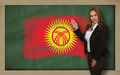 Teacher showing flag ofkirghizstan on blackboard for presentatio - PhotoDune Item for Sale